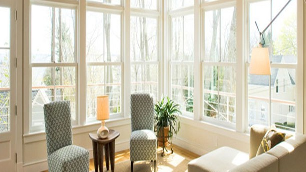 Sun room with full length windows on two exterior walls